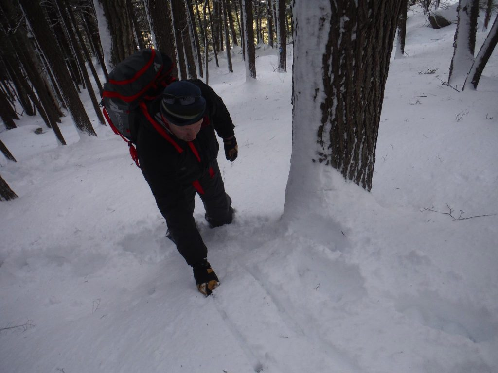 Here our apt pupil uses his ice axe to aid clearing a bulge